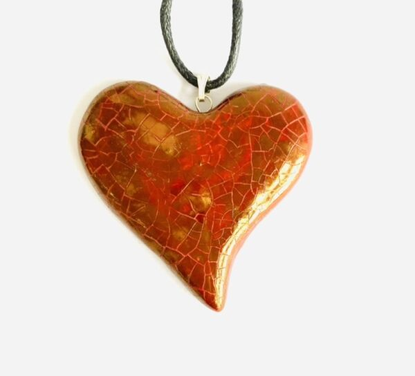 Red heart ceramic pendant.