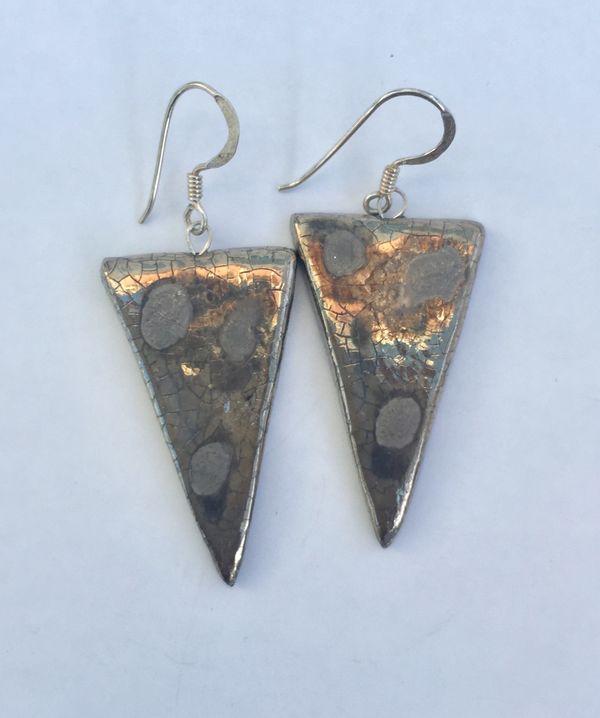Triangle silver drop earrings.