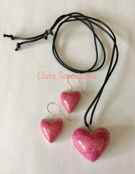 Pink heart pendant and earring set.