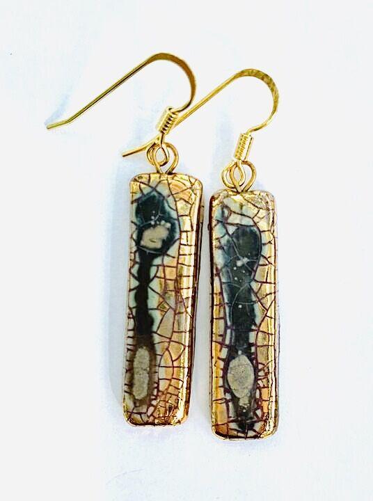 Gold rectangular ceramic earrings with crackled glaze.