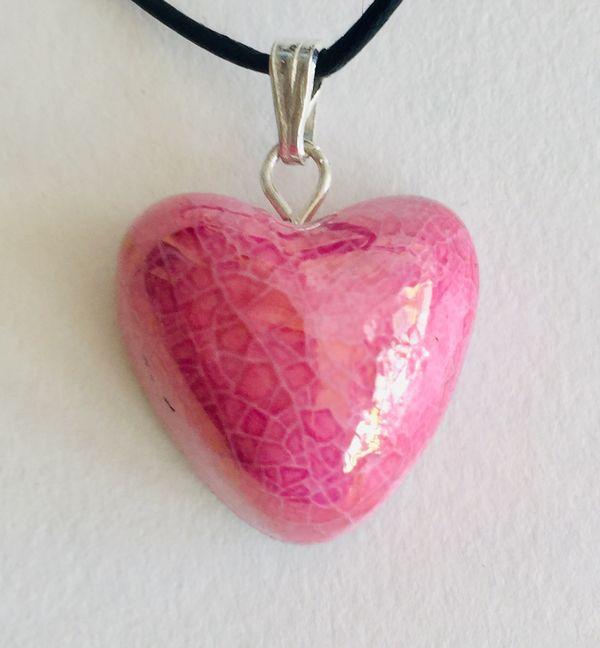 Pink heart ceramic pendant.