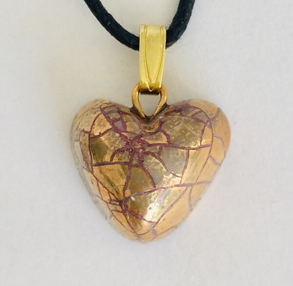 Small gold heart pendant.