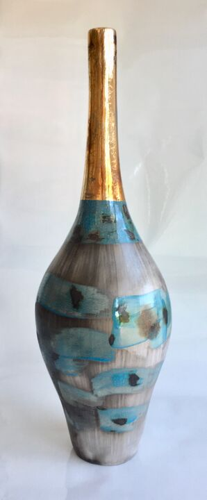 Tall blue smoke-fired pot.