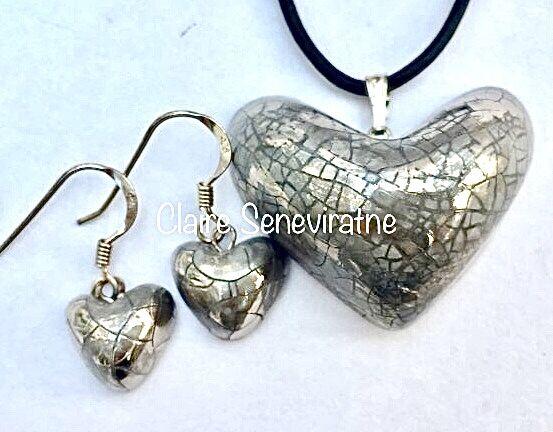 Silver heart jewellery set.