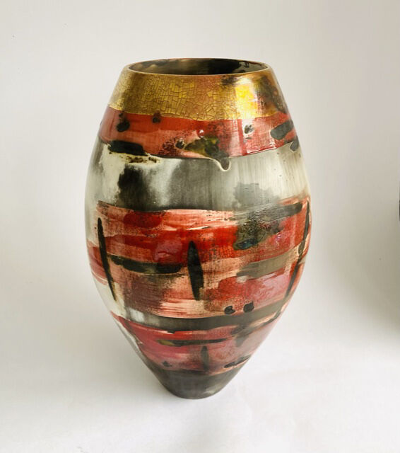 Large red sawdust fired vessel.