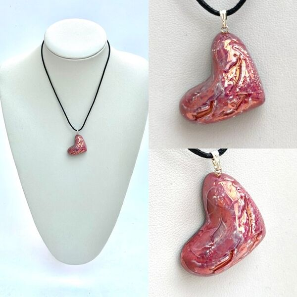 Pink heart pendant hung on its side.