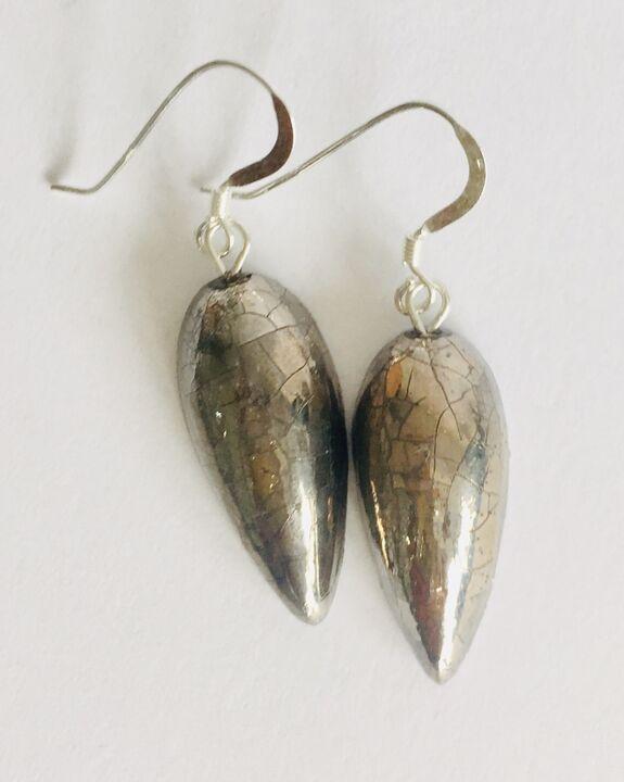 Silver teardrop ceramic earrings.
