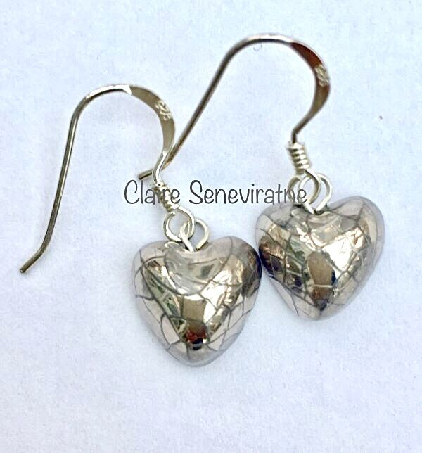 Heart earrings with silver lustre.
