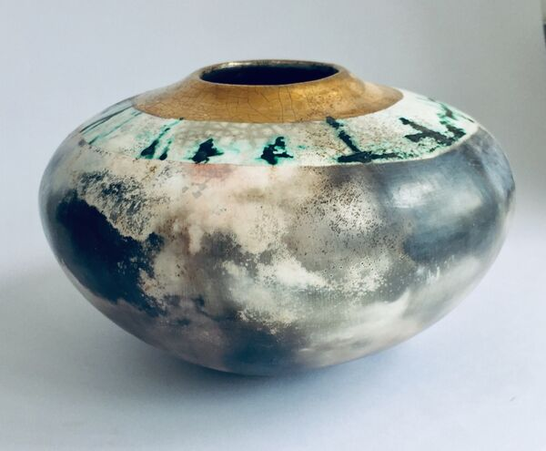 Large smoke-fired ceramic pot with gold lustre.