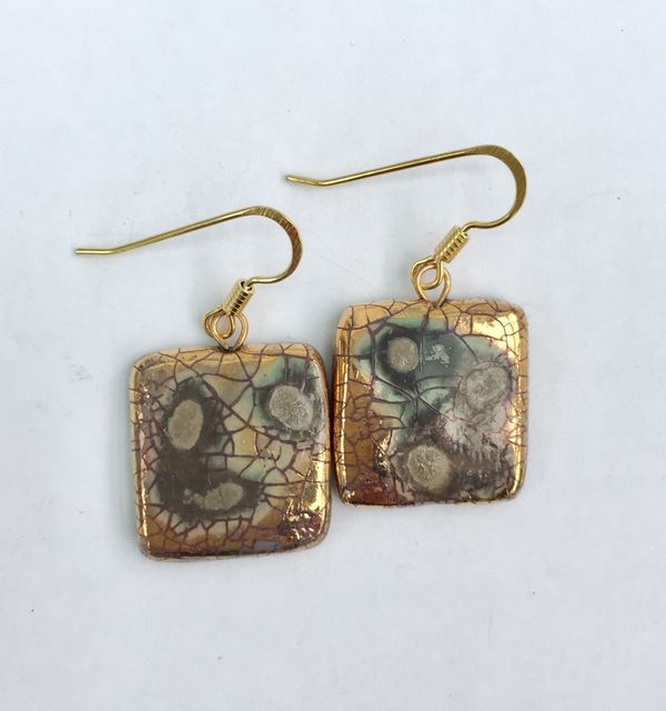 Square gold drop earrings.