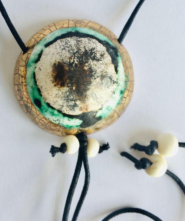 Gold smoke fired pendant.