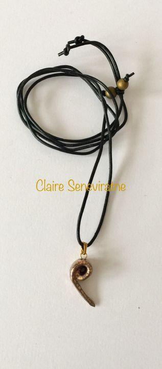 Gold spiral ceramic pendant.
