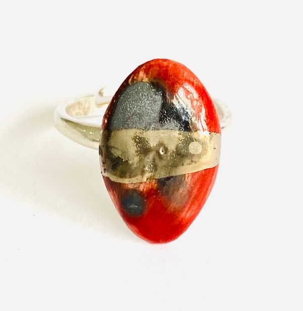 Red porcelain ring mounted on to a sterling silver band.