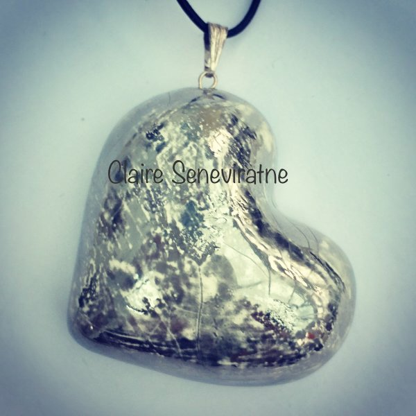 Large ceramic silver heart pendant.