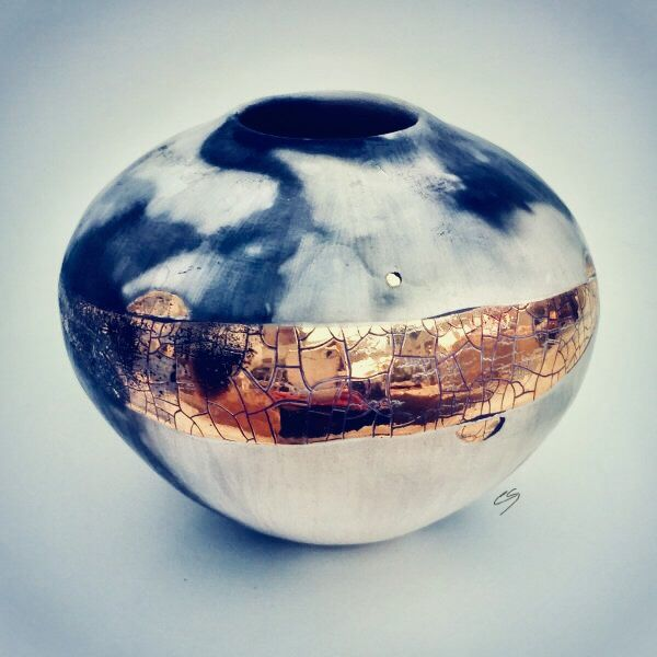 Small ceramic pot with gold lustre.