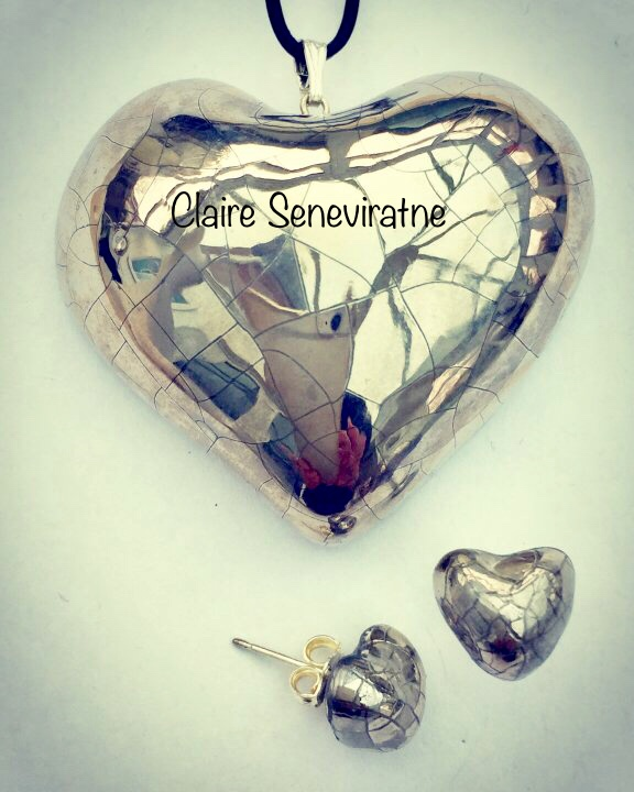 Silver heart pendant with silver heart stud earrings.