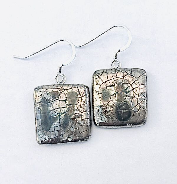 Square silver drop earrings.