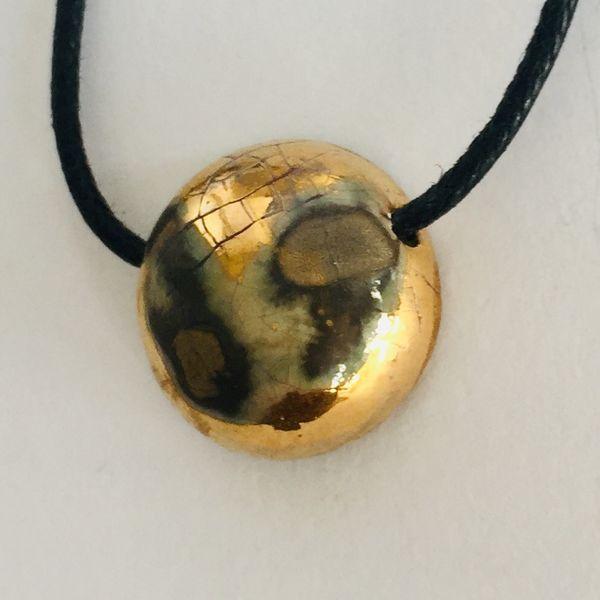 Raku style ceramic pendant.