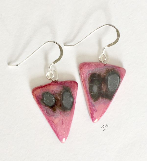 Pink triangle ceramic earrings with silver grey patterns.