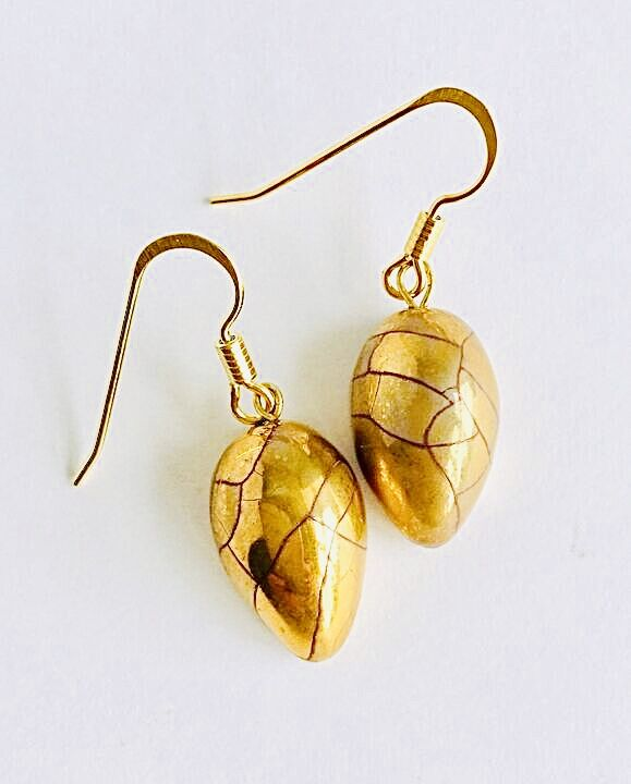 Gold teardrop earrings.