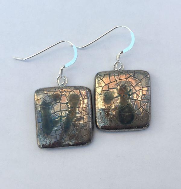 Square silver drop earrings.