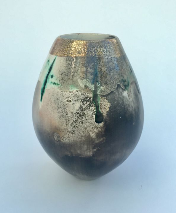 Sawdust fired ceramic pot partial glaze and gold lustre.