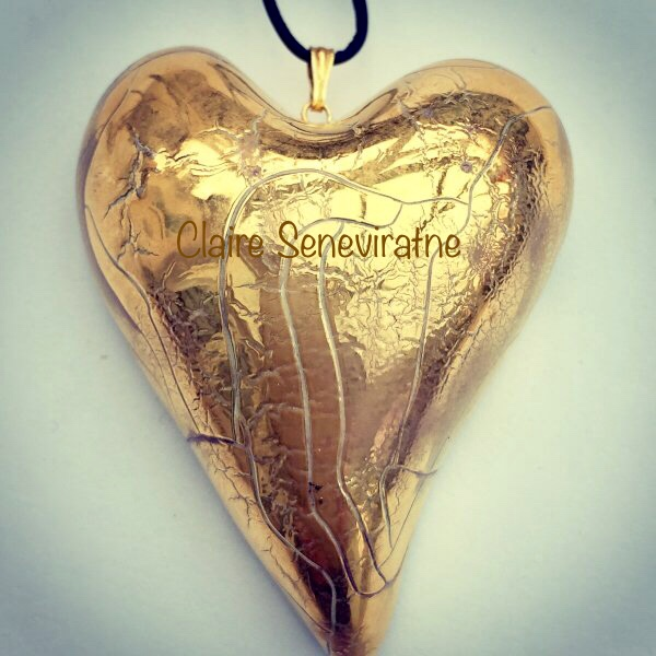 Large gold lustre heart pendant.