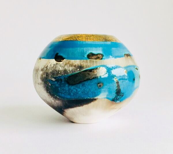 Blue smoke-fired ceramic pot with gold lustre.