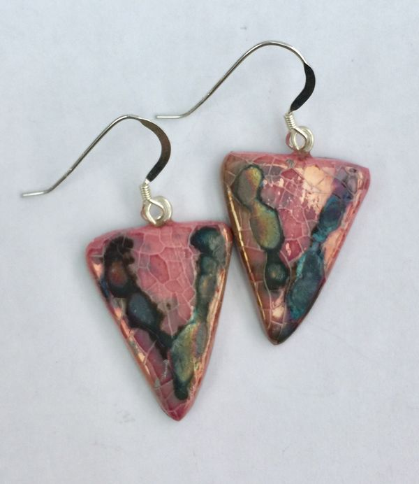 Pink triangle drop earrings with iridescent colours.