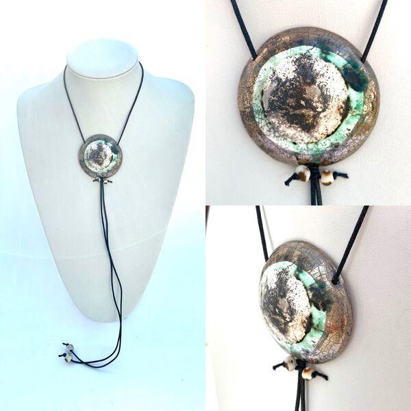 Large silver smoke fired pendant.