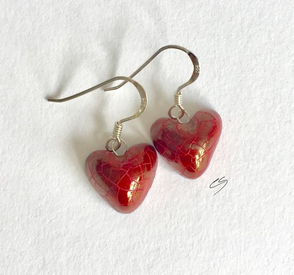 Red lustre heart drop earrings.