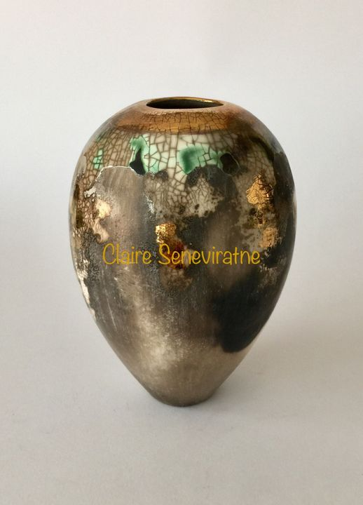 Medium smoke fired vessel with gold.