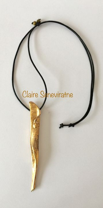 Gold sculptural long pendant.