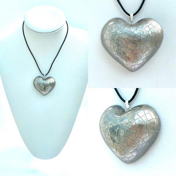 Large silver heart pendant.