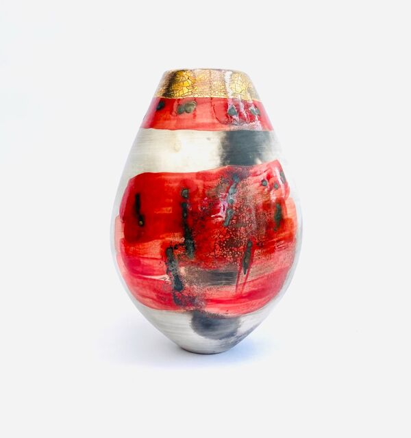 Red smoke-fired pot with gold lustre.