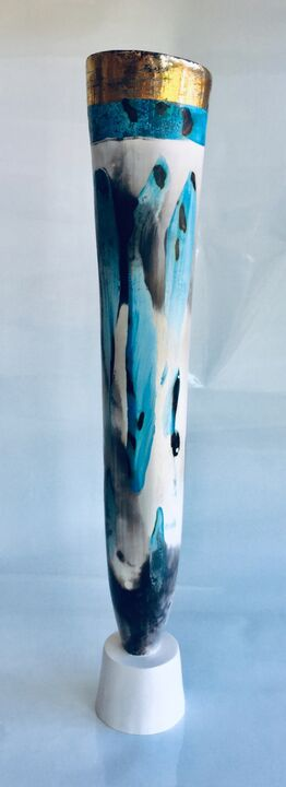 Tall blue smoke-fired vessel on a stand.