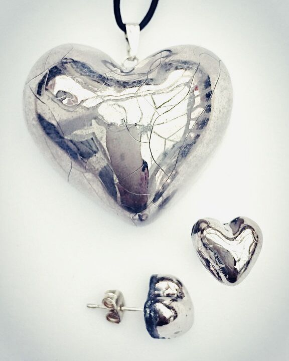 Large silver heart pendant with heart studs.
