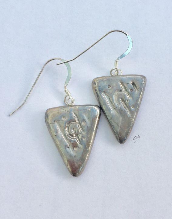 Silver triangle earrings.