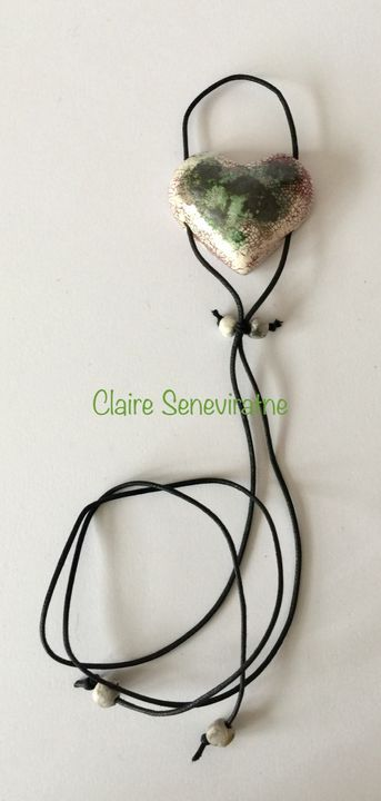 Heart pendant with black green and pink.