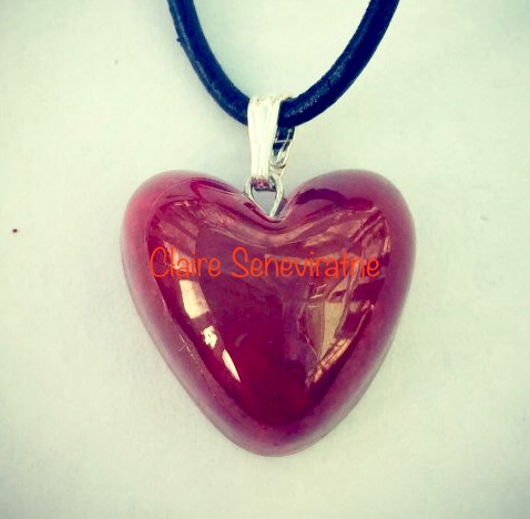 Small red heart pendant.