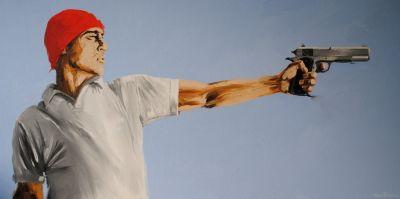 Man In a Red Hat With a Handgun