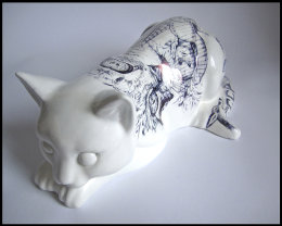 'Chernobyl Cat', Front View: black Biro drawing on found Ceramic Cat Figurine