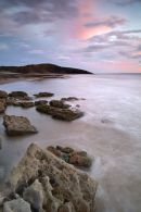 View across Dunraven Bay to Witches Point, dusk