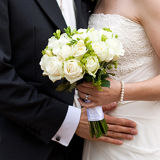 Simple & elegant, hand ties white roses & freesias