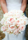Simple, elegant bouquet of pale pink hand tied roses