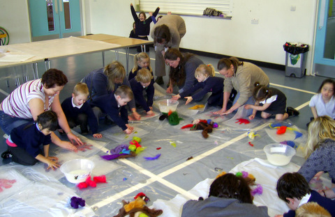 Parents and children beginning the felting process