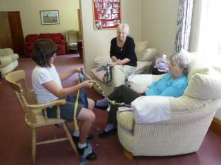Starting to plait: student with residents of Hevingham Rectory