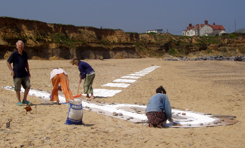 Cutting Edge: 100m of giant chalk image on Happisburgh Beach
