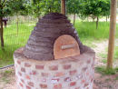 Beehive design of earth oven with wooden door