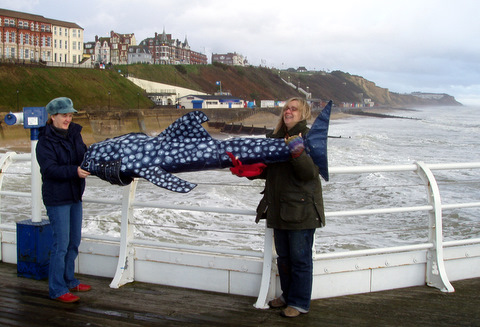 Jessica with artist Meg Foster at Cromer Pier Oct 2010, with 'Elvis' the whale shark.